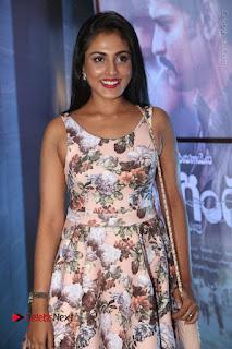 Actress Madhu Shalini Stills in Floral Short Dress at RGV Shiva to Vangaveeti Event  0035.JPG