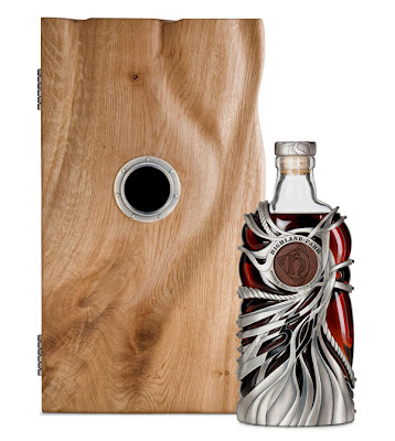 Highland Park 50 year old scotch whisky limited edition bottle and oak cask