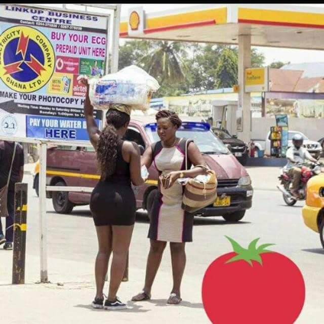 From a movie or what? Viral photos of a bootilicious lady on mini dress selling satchet water in Ghana