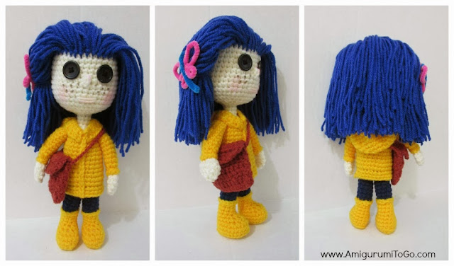 crochet doll with yellow jacket