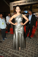 Rakul Preet Singh in Shining Glittering Golden Half Shoulder Gown at 64th Jio Filmfare Awards South ~  Exclusive 056.JPG
