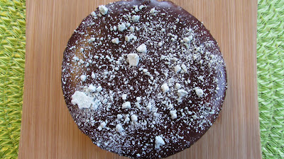 4 inch Peppermint cheesecake base, chocolate graham cracker crust, covered in chocolate, sprinkled with mint chips