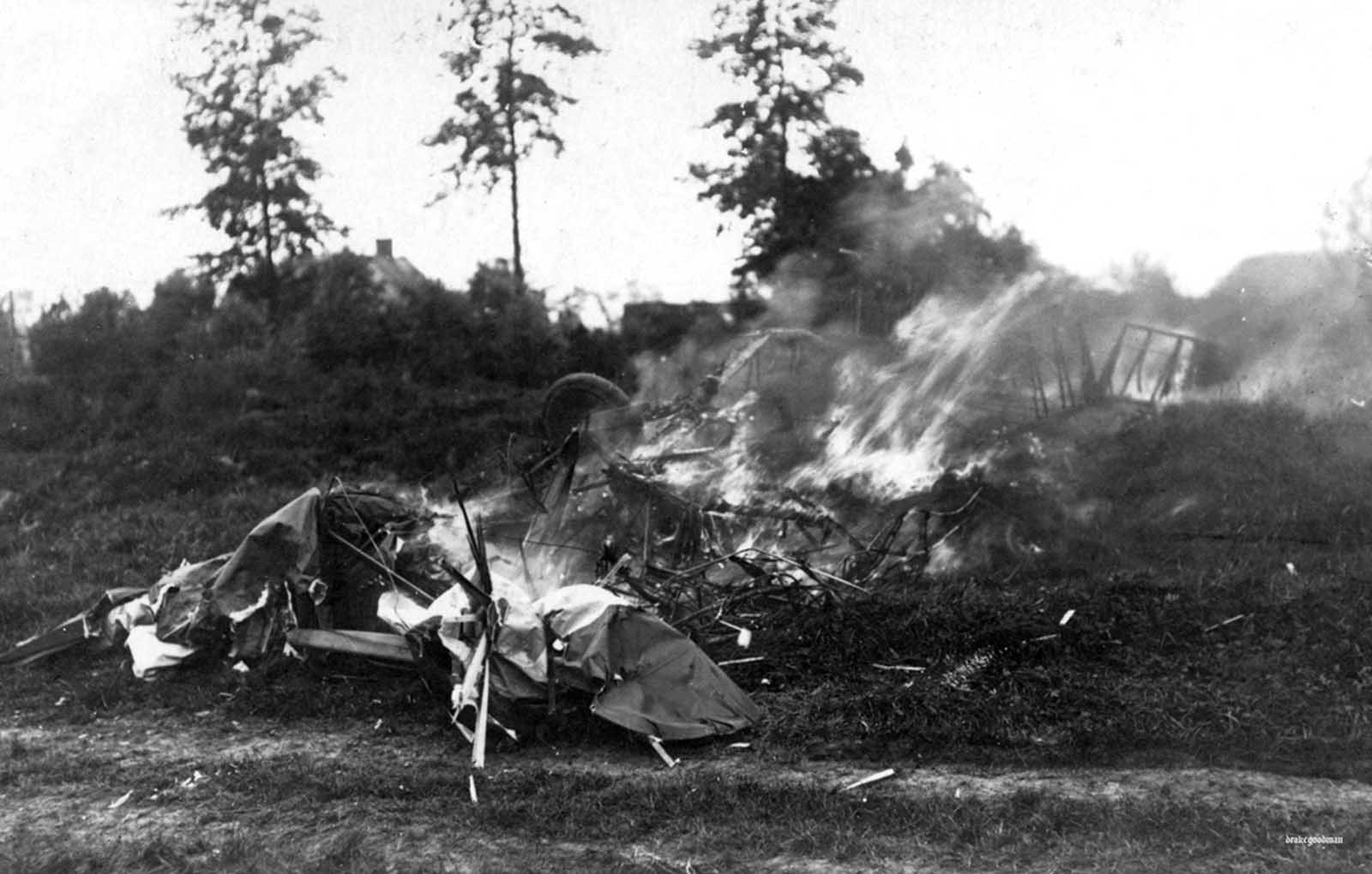 An aircraft. crashed and burning in German territory, ca. 1917.