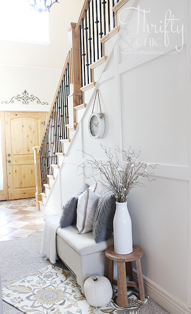 Two story entrway or foyer. White and neutral decor and decorating ideas for Fall.