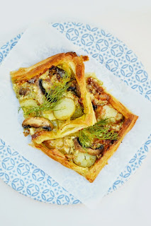 A simple puff tart topped with pesto, brie, potatoes and mushroom. Good served warm or cold.