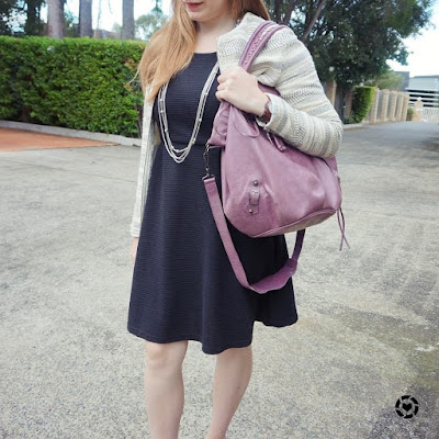 awayfromblue instagram lilac purple balenciaga pompon worn on shoulder with little black dress