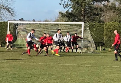 Football action from the game between Limestone Rangers (red shirts) and Barnetby United at Willoughton - Saturday, February 9, 2019