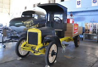 antique flatbed truck with vintage fuel pump and gas can