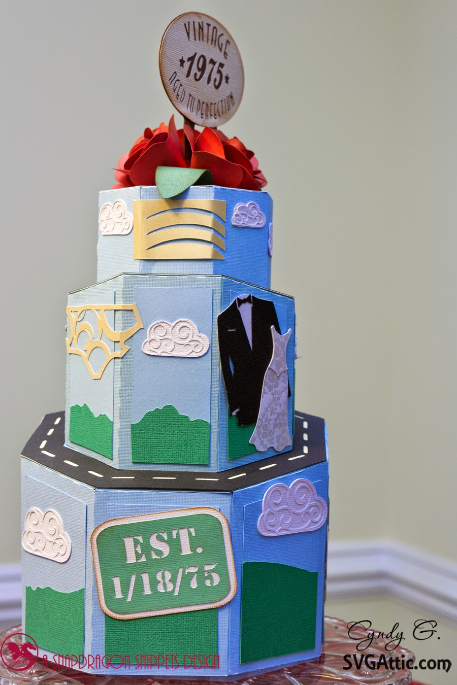3d paper cake with life milestones i.e. born, wedding, children, etc.