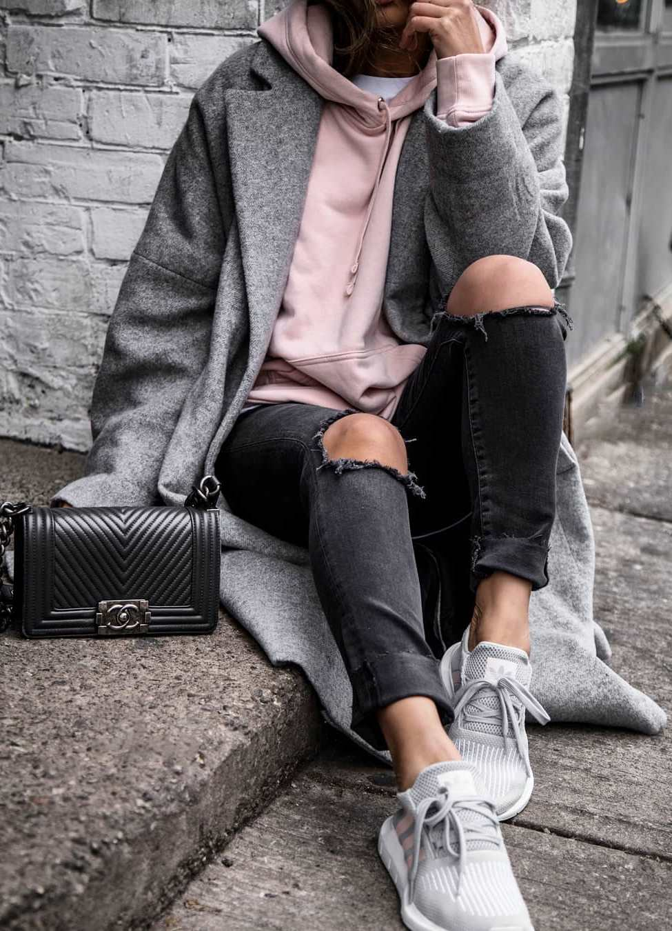 awesome fall outfit / grey coat + pink hoodie + rips + black bag + sneakers