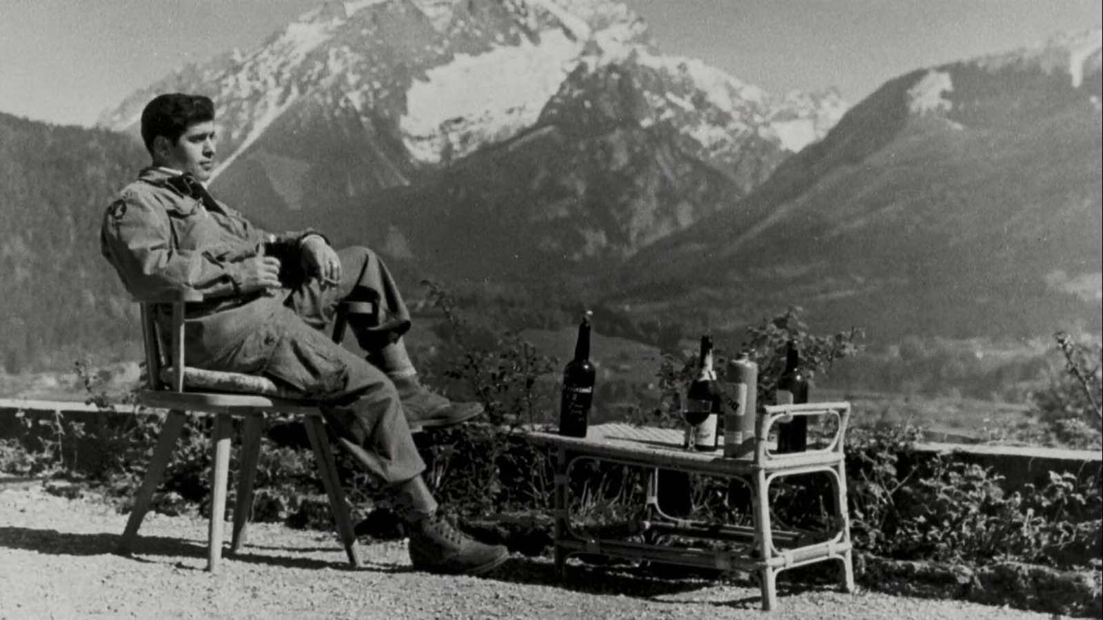 A paratrooper of the 101st Airborne Division enjoying the view and a cognac while lounging on the terrace of Hitler's retreat at Berchtesgaden after the end of the war in 1945.