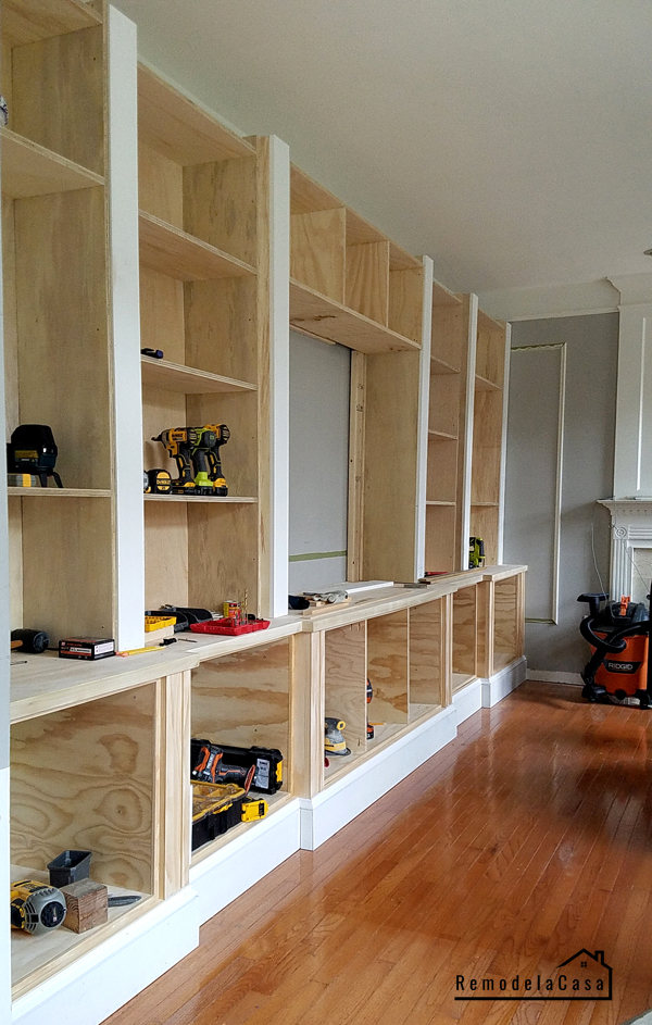 shelves being constructed with lots of power tools on them