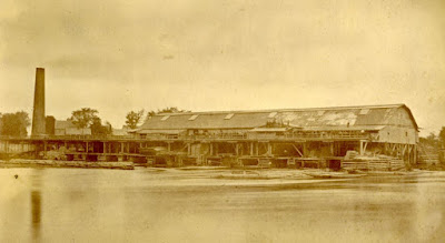 Sepia photograph of lumber mill