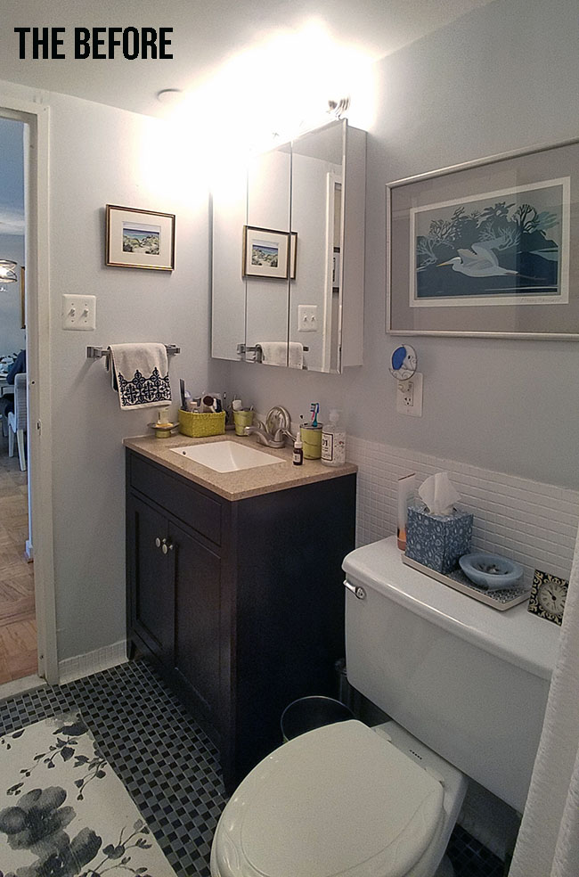 small bathroom with dark vanity, huge toilet and protruding medicine cabinet