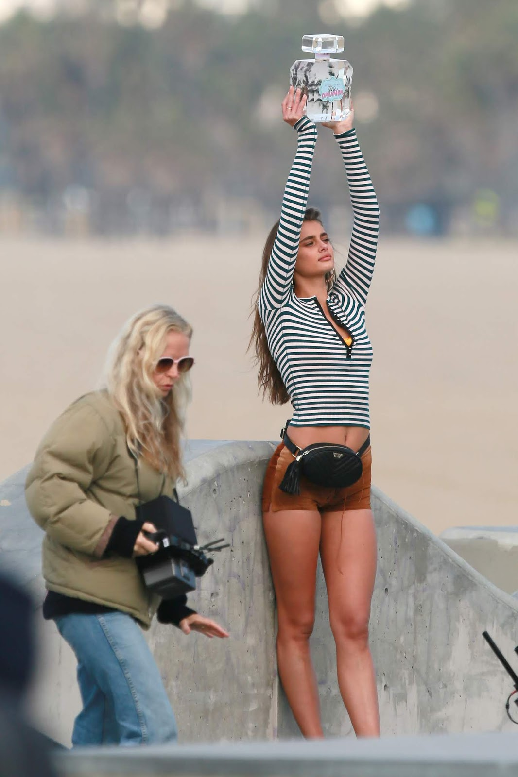 Taylor Hill shoots a new Tease Dreamer perfume commercial for Victoria's Secret in Venice Beach