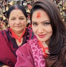 Indira Joshi Family Husband Son Daughter Father Mother Age Height Biography Profile Wedding Photos