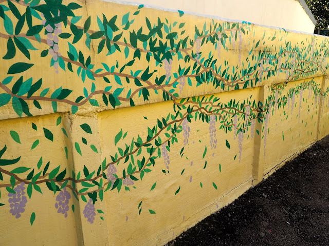 Grape vines and leaves street art in the Ji-dong mural village in Suwon, South Korea