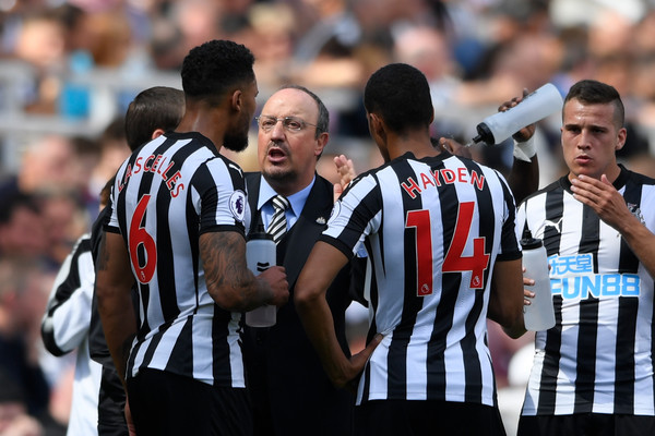 Rafael Benitez, Manager of Newcastle United speaks to Jamaal Lascelles of Newcastle United and Isaac Hayden of Newcastle United during the Premier League match between Newcastle United and Tottenham Hotspur at St. James Park on August 13, 2017 in Newcastle upon Tyne, England. (Aug. 12, 2017 - Source: Stu Forster/Getty Images Europe)