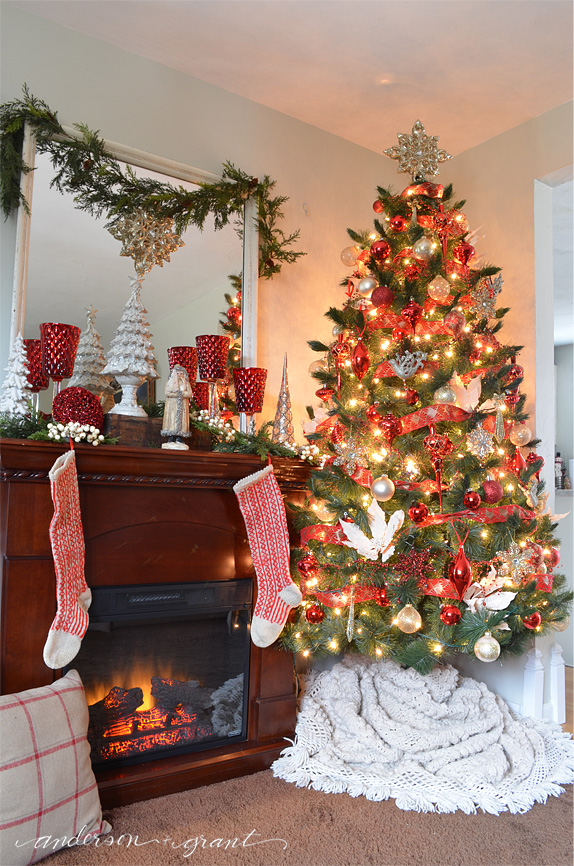 Christmas tree decorated with reds, creams, golds, and silvers.....and a tree skirt made from a bedspread! | www.andersonandgrant.com
