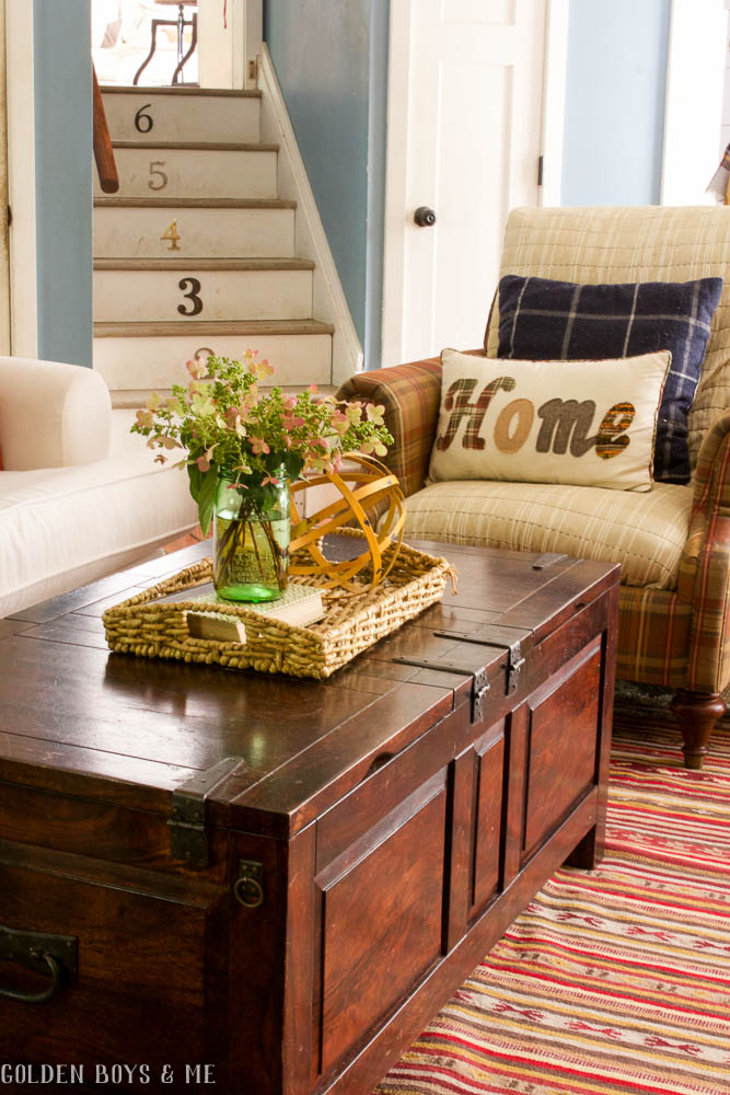 Trunk style coffee table and numbered stairs with plaid in fall decor - www.goldenboysandme.com