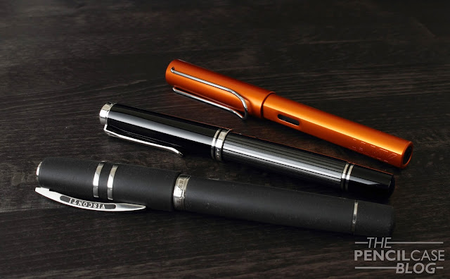 Visconti Homo Sapiens Steel oversize, Pelikan Souverän M805 Stresemann, and Lamy All-Star Copperorange