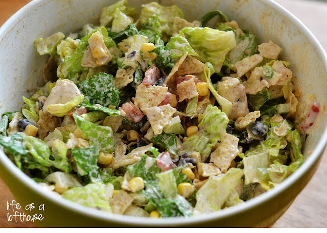 This Southwest Chicken Chopped Salad is filled with grilled chicken, romaine lettuce and lots of colorful veggies tossed in a taco-ranch dressing. Life-in-the-Lofthouse.com