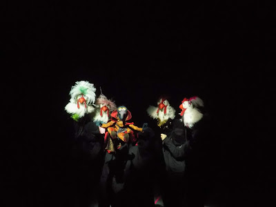 Puppeteers in black support the Great Gonzo and a cast of chickens