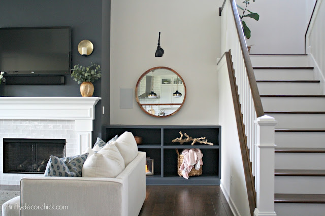 Built in bookcases by fireplace