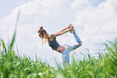 Fit woman hiker stretching