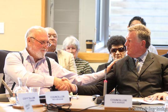 L-R: Cr Rex Graham, Hastings, congratulated on being elected chairman, by Cr Rick Barker, Hastings, who was later elected deputy chairman, at the first meeting of the new Hawke's Bay Regional Council, Napier. photograph