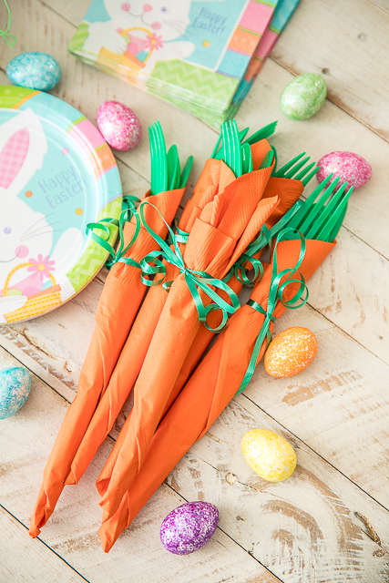 Easy Easter Dessert Table with festive Carrot Napkins and an I Love Ice Cream Carvel® Oreo® Ice Cream Cake. Make Easter dessert a breeze with this yummy ice cream cake! Make sure your Easter table is festive and make these adorable and easy Carrot Napkins bundles.Great way for the kids to help set the table. GIF tutorial included #Easter #table #carrotnapkins