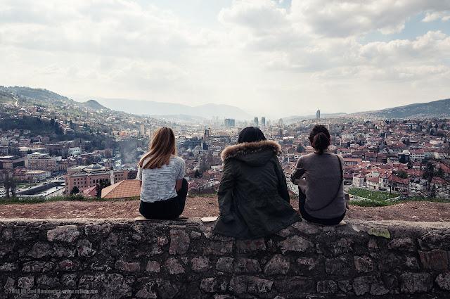 three girls on a  hill overlooking Sarajevo