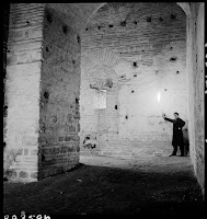 Anema Tower, the internal-L-shaped Chamber, March 1937.  An unknown man holding a torch photographed inside the Anema Tower, the Palace of Vlachernae (12th century) [Credit: © Nicholas V. Artamonoff Collection, Image Collections and Fieldwork Archives, Dumbarton Oaks]