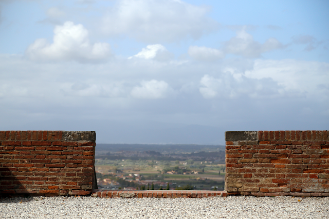 Views through brick wall of Tuscan Rolling Countryside in Italy