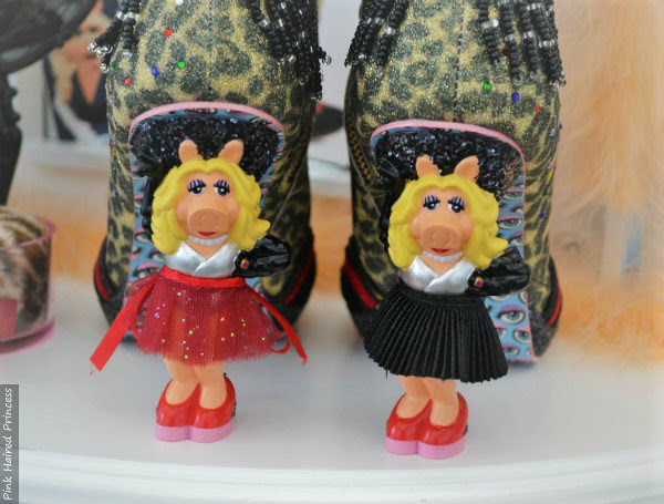 Miss Piggy character heels with red glitter skirt and with black pleated skirt