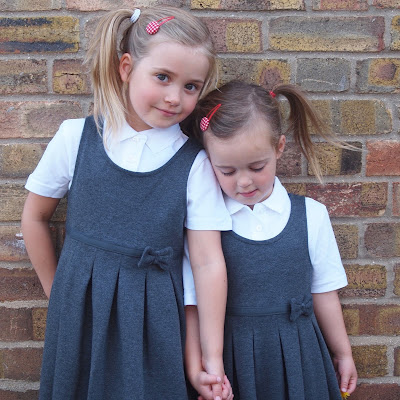 Marks and Spencer school uniform - pinafore dresses and polo shirts