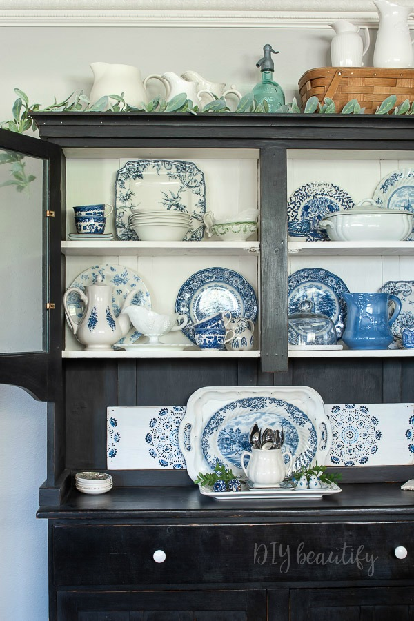 blue and white dishes in hutch