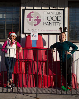 Lead Food Elves Ellie Teixeira (left) and Julia Buccella distributed red bins to 11 Franklin Downtown Partnership member businesses