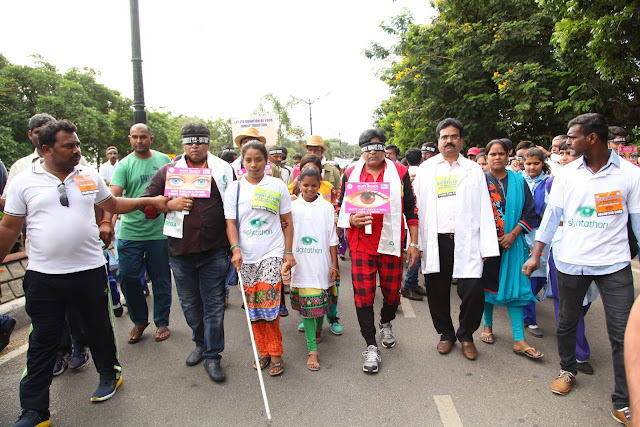 Ali blind fold at walk with Visually Challenged