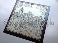Socarrat que nos muestra en primer término las Torres dels Serrans, catedral y el Micalet.