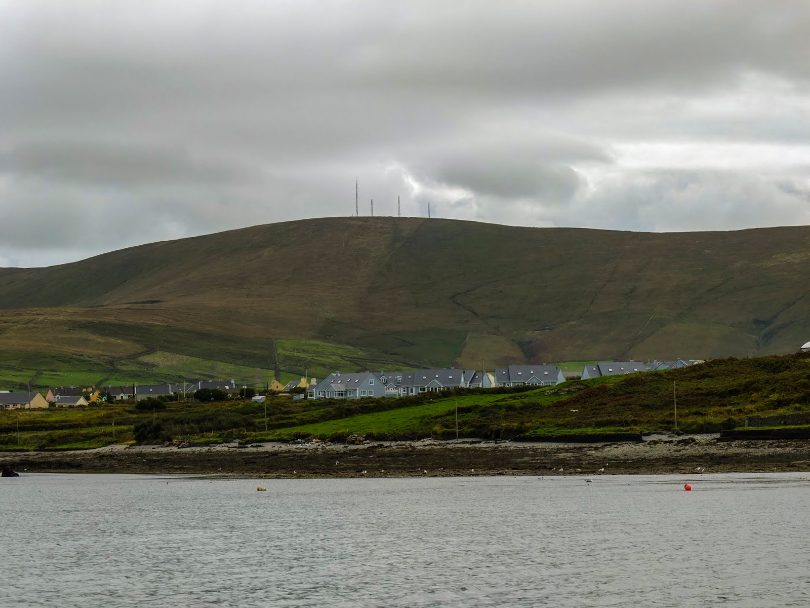 A mountain side on the Iveragh Peninsula captured from the water.