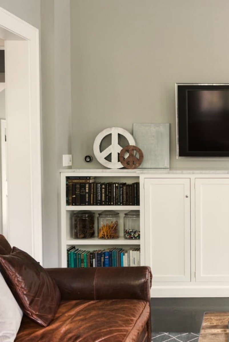 Modern farmhouse great room with white built-ins for media wall on Hello Lovely Studio