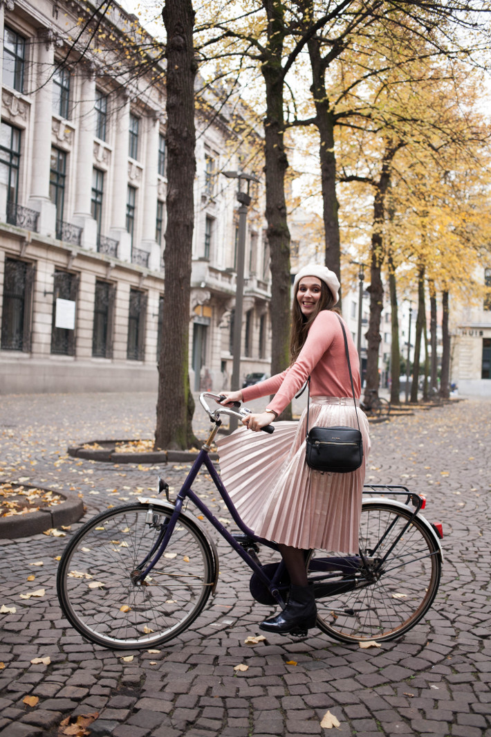 pink metallic pleated skirt, lace up booties