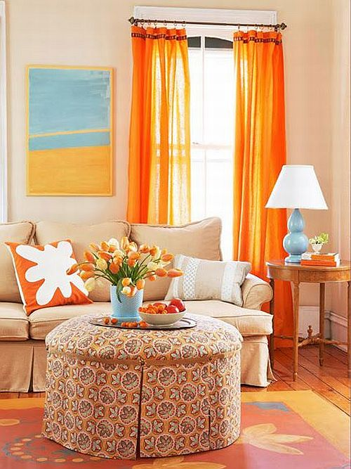 pretty living room with turquoise and orange curtains