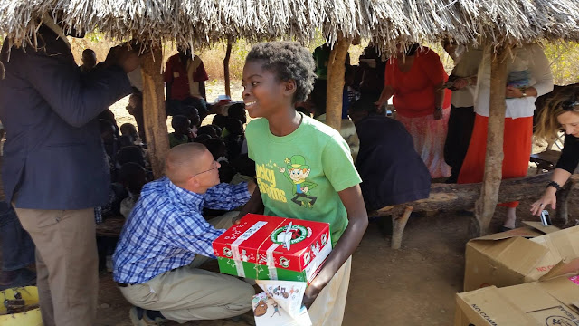 Girl  in Zambia with her Operation Christmas Child shoeboxe.