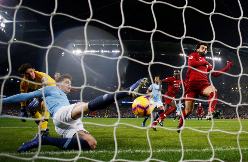 1d01aedabc1 John Stones somehow cleared off the line in Liverpool s defeat at Man City.  Pic credit  Reuters.