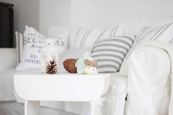 Grey striped cushions on the couch