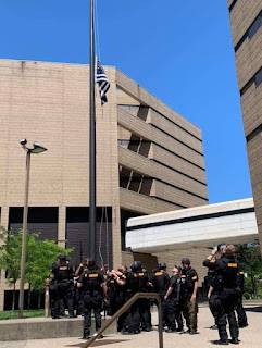 Cincinnati police raising racist flag
