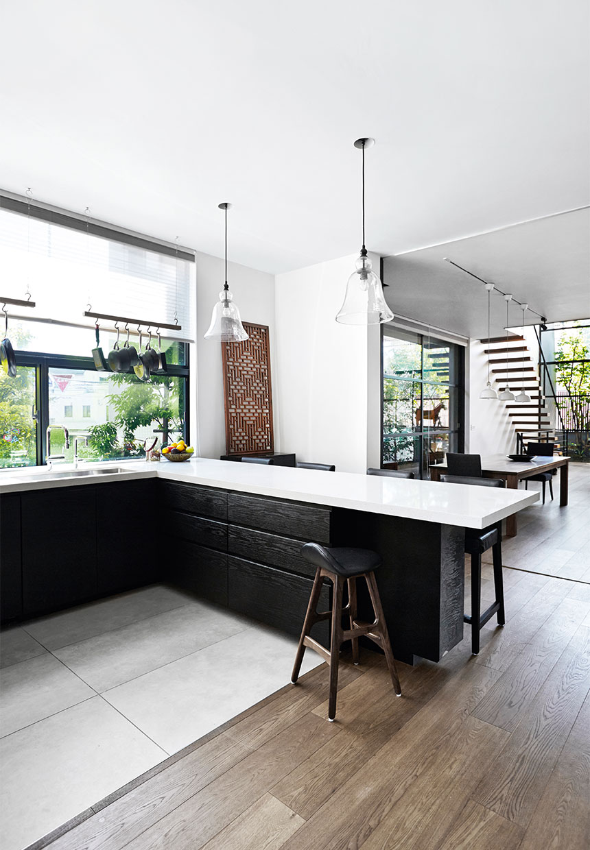 Kitchen inside of a japanese house, wood floors, black cabinets