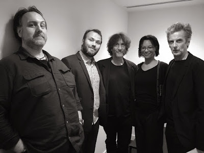 B&W photo showing 5 people  Mitch Benn, John Finnemore, Neil Gaiman, Nina Sosanya and Peter Capaldi